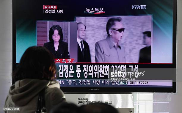 South Koreans watch a television broadcast following the announcement of the death of North Korean leader Kim JongIl at the Seoul Railwat Station on...