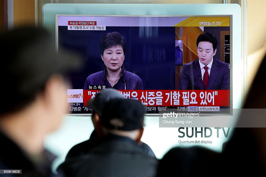 South Koreans watch a television broadcast reporting the political scandal on November 3, 2016 in Seoul, South Korea. The prosecutors were issued an arrest warrant for Choi Soon-sil for allegedly influencing state affairs and embezzling money by taking advantage of her close relationship with President Park Geun-hye.