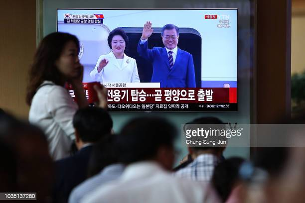 South Koreans watch a television broadcast reporting the South Korean President Moon Jaein and his wife Kim Jungsook departing to North Korea at the...