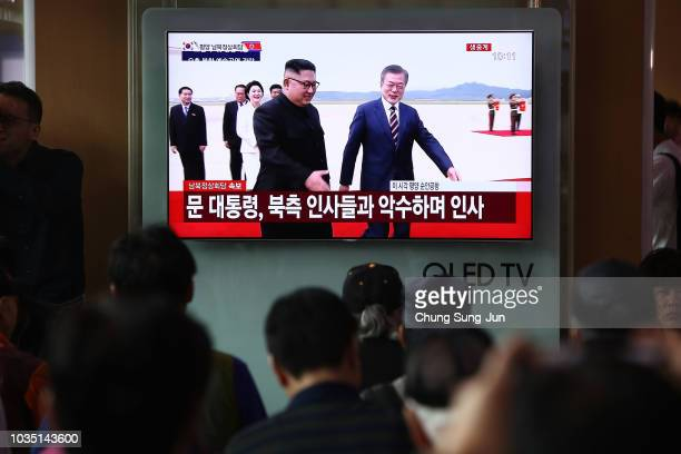 South Koreans watch a television broadcast reporting the South Korean President Moon Jaein meeting with North Korean Leader Kim Jong Un at the Seoul...