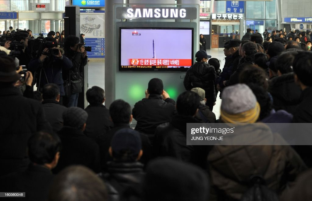 South Koreans watch live footage of South Korea's third attempt of a rocket launch on a television set (C) at a railway station in Seoul on January 30, 2013 as the 140-tonne Korea Space Launch Vehicle (KSLV-I) blasted off at 4:00 pm (0700 GMT) from the Naro Space Center on the south coast. South Korea launched a rocket on January 30 in its third bid to put a satellite in orbit -- a high-stakes challenge to national pride after rival North Korea succeeded in the same mission last month.