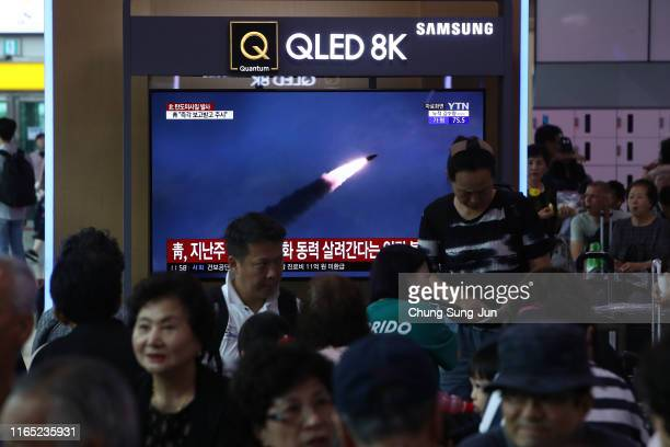 South Koreans watch on a screen a file image of reporting North Korea's missile launch on July 31 2019 in Seoul South Korea North Korea fired two...