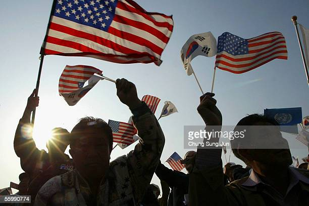 South Koreans wave US and South Korea flags during a rally to mark the 60th anniversary of the UN foundation in front of City Hall on October 24 2005...