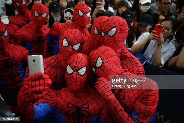 South Koreans wear SpiderMan cloths during the 'SpiderMan Homecoming' Seoul Premiere at Yeongdeunpo Times Square on July 2 2017 in Seoul South Korea