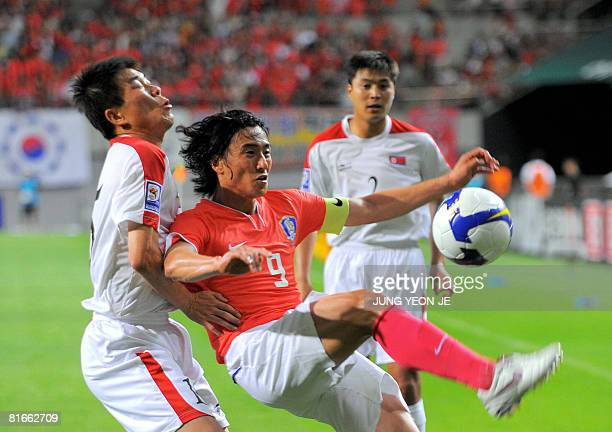 South Korea's Ahn JungHwan fights for the ball against North Korea's Kim YongJun during their 2010 FIFA World Cup qualifying football match in Seoul...