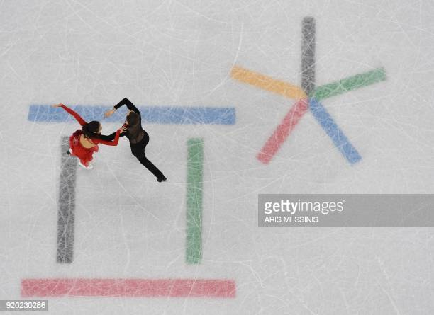 South Korea's Alexander Gamelin and South Korea's Yura Min compete in the ice dance short dance of the figure skating event during the Pyeongchang...