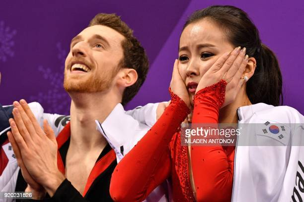 South Korea's Alexander Gamelin and South Korea's Yura Min react after competing in the ice dance short dance of the figure skating event during the...