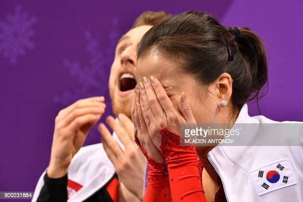 TOPSHOT South Korea's Alexander Gamelin and South Korea's Yura Min react after competing in the ice dance short dance of the figure skating event...