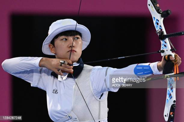 South Korea's An San competes in the women's individual eliminations during the Tokyo 2020 Olympic Games at Yumenoshima Park Archery Field in Tokyo...