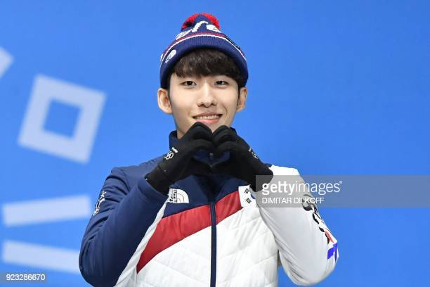 TOPSHOT South Korea's bronze medallist Lim Hyojun makes a heart shape as he poses on the podium during the medal ceremony for the short track Men's...
