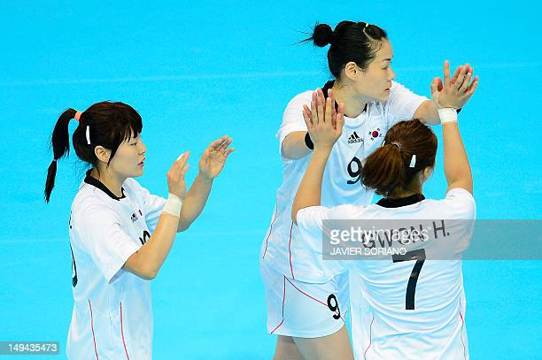 South Korea's centreback Jung Jihae pivot Kim Cha Youn and leftback Gwon Han Na celebrate their victory on Spain by 3127 at the end of the women's...