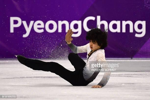 South Korea's Cha Junhwan falls in the men's single skating free skating of the figure skating event during the Pyeongchang 2018 Winter Olympic Games...