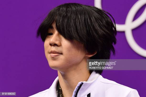 South Korea's Cha Junhwan reacts after competing in the men's single skating free skating of the figure skating event during the Pyeongchang 2018...