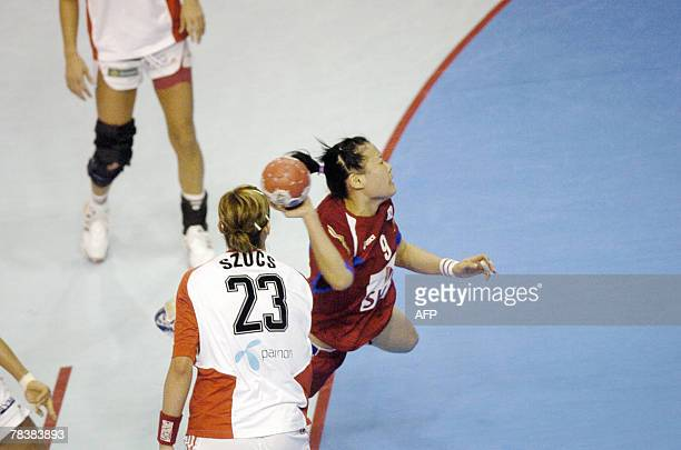 South Korea's Chayoun Kim tries to score despite Hungary's Gabriella Szucs during the women world championship handball match Hungary vs South Korea...