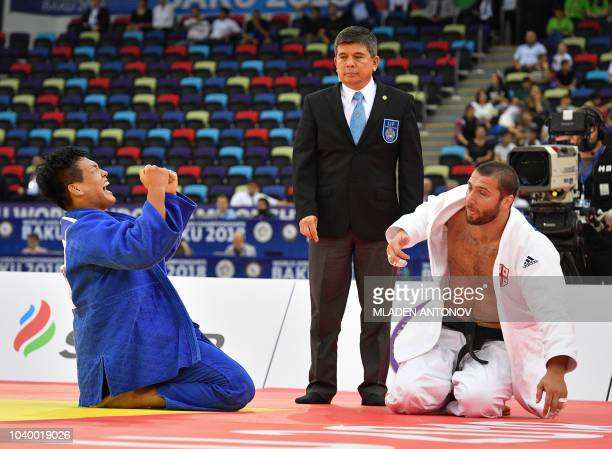South Korea's Cho Guham celebrates his victory against Georgia's Varlam Liparteliani in the men's under 100kg category gold medal bout of the 2018...