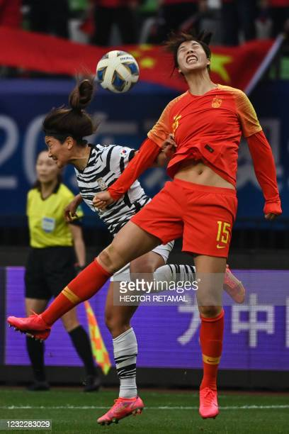 South Korea's Cho So-hyun and China's Yang Man compete for the ball during the qualifying play-off second leg women's football match for the Tokyo...