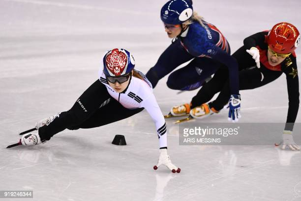 TOPSHOT South Korea's Choi Minjeong Britain's Elise Christie and China's Li Jinyu compete in the women's 1500m short track speed skating semifinal...