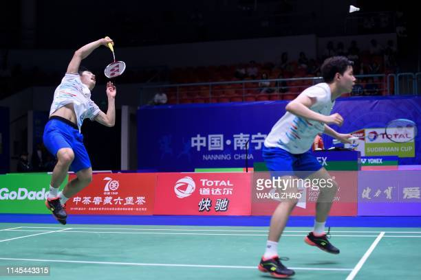 South Korea's Choi Solgyu hits a return behind partner Seo Seungjae against Taiwan's Lee Yang and Wang Chi Lin during their men's doubles match at...
