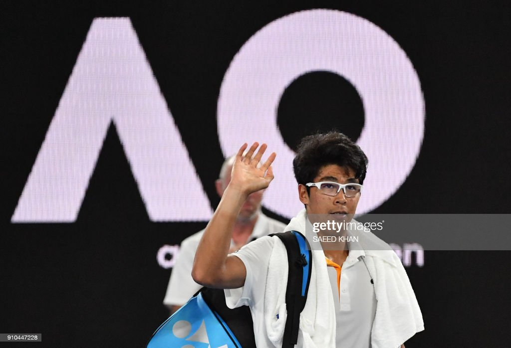 South Korea's Chung Hyeon reacts after retiring against Switzerland's Roger Federer during their men's singles semi-finals match on day 12 of the Australian Open tennis tournament in Melbourne on January 26, 2018. /