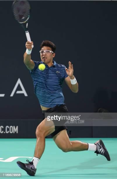South Korea's Chung Hyeon returns the ball to Russia's Karen Khachanov during the Mubadala World Tennis Championship at Zayed Sports City in Abu...