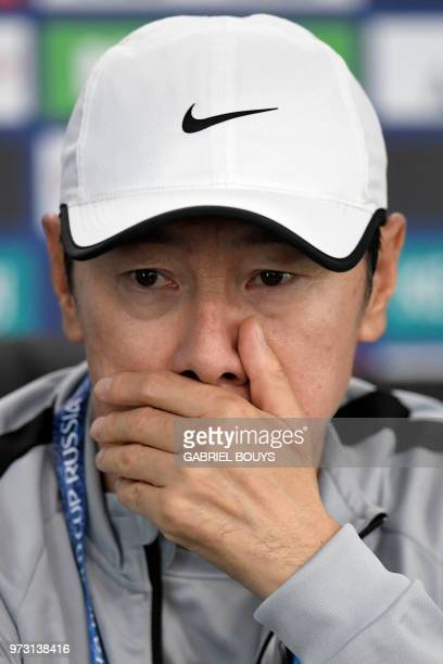 South Korea's coach Shin Taeyong attends a press conference at the Spartak Stadium in Saint Petersburg on June 13 ahead of the Russia 2018 World Cup...