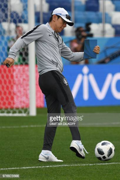 South Korea's coach Shin Taeyong attends a training session at Nizhny Novgorod Stadium in Nizhny Novgorod on June 17 on the eve of the team's Russia...