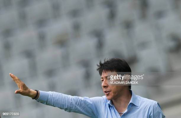 South Korea's coach Shin Taeyong gestures during their international friendly football match between South Korea and Bolivia at Tivoli stadium in...