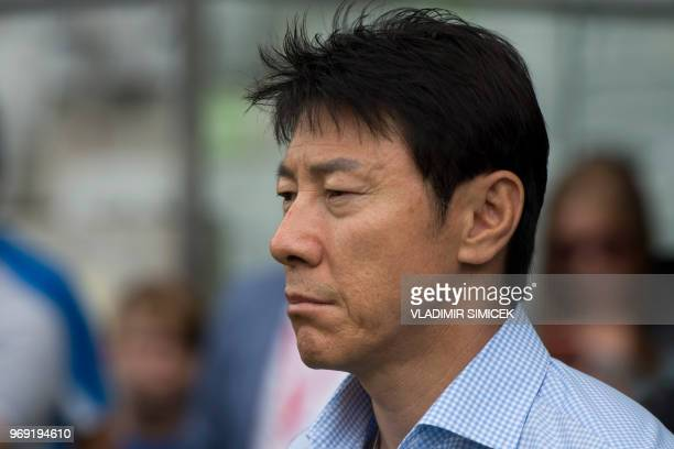 South Korea's coach Shin Taeyong reacts during the international friendly football match between South Korea and Bolivia at Tivoli stadium in...