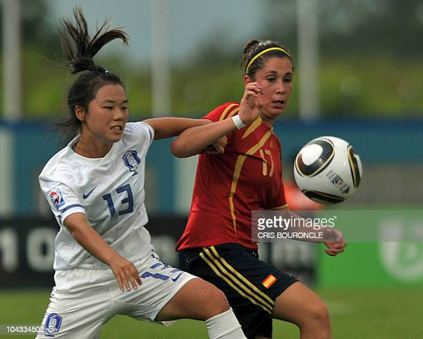 South Korea's defence Soojin Joo vies for the ball with Spanish midfield Sara Merina during the FIFA Women's Under17 semifinal match on September 21...