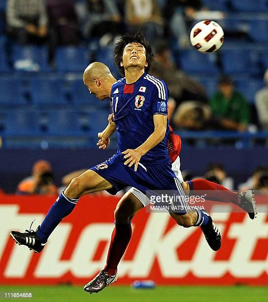 South Korea's defender Cha Du-Ri challenges Japan's forward Ryoichi Maeda during their 2011 Asian Cup semi-final football match at Al-Gharafa Stadium...