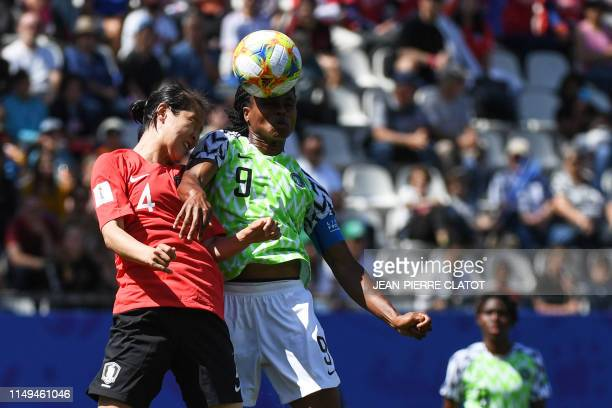 South Korea's defender Hwang Boram jumps for the ball with Nigeria's forward Desire Oparanozie during the France 2019 Women's World Cup Group A...