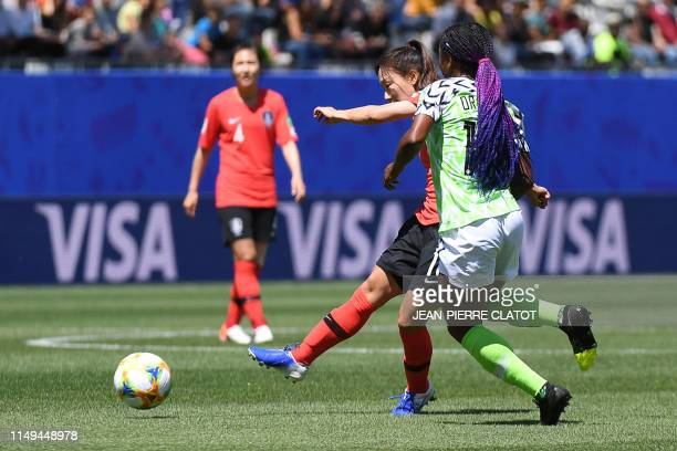 South Korea's defender Jang Selgi vies for the ball with Nigeria's forward Francisca Ordega during the France 2019 Women's World Cup Group A football...