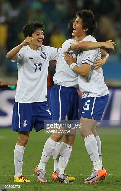 South Korea's defender Kim DongJin and South Korea's midfielder Lee ChungYong celebrate after their Group B first round 2010 World Cup football match...