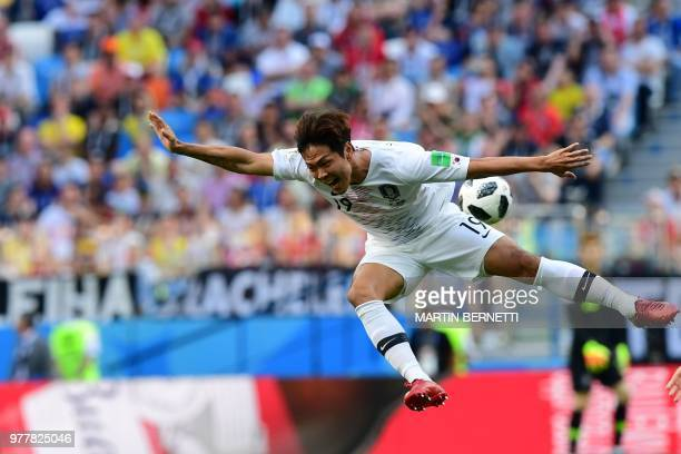 South Korea's defender Kim Young-gwon attempts a header during the Russia 2018 World Cup Group F football match between Sweden and South Korea at the...
