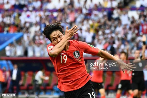TOPSHOT South Korea's defender Kim Younggwon celebrates after scoring a goal during the Russia 2018 World Cup Group F football match between South...