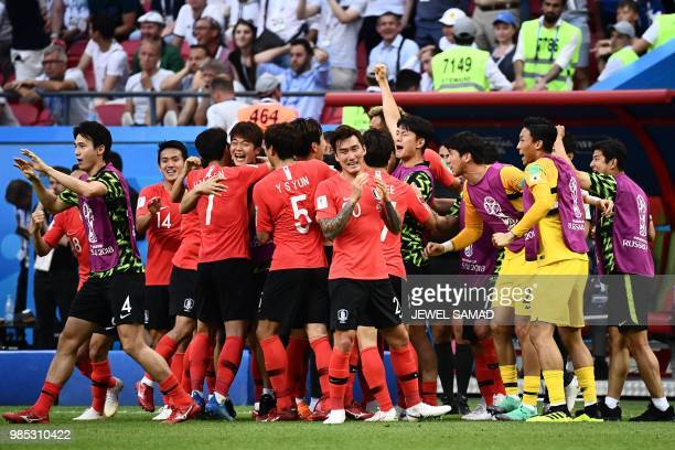 TOPSHOT South Korea's defender Kim Younggwon celebrates with teammates after scoring a goal during the Russia 2018 World Cup Group F football match...