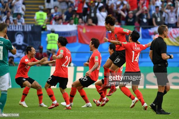 South Korea's defender Kim Younggwon celebrates with teammates after scoring a goal during the Russia 2018 World Cup Group F football match between...