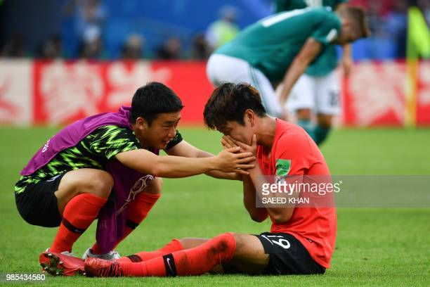 South Korea's defender Kim Younggwon cries as he celebrates with a teammate after winning at the end of the Russia 2018 World Cup Group F football...