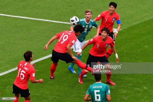 TOPSHOT South Korea's defender Kim Younggwon heads the ball during the Russia 2018 World Cup Group F football match between South Korea and Germany...