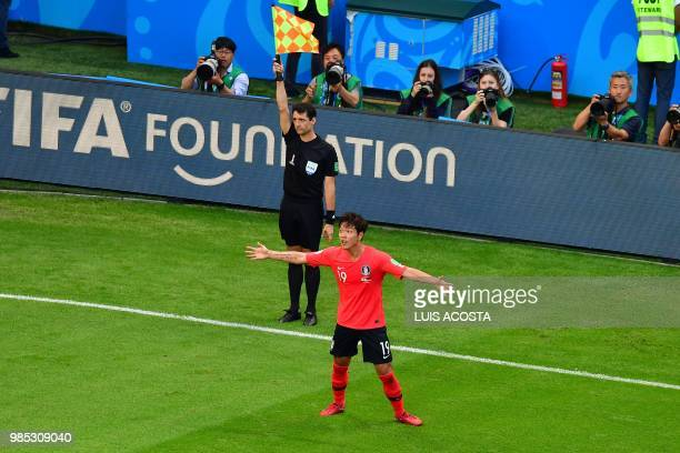 TOPSHOT South Korea's defender Kim Younggwon reacts after an offside flag during the Russia 2018 World Cup Group F football match between South Korea...