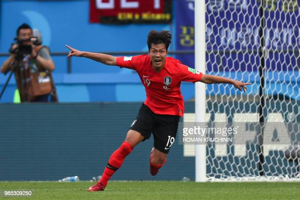 TOPSHOT South Korea's defender Kim Younggwon runs to celebrate his goal during the Russia 2018 World Cup Group F football match between South Korea...