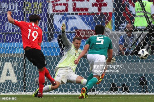 TOPSHOT South Korea's defender Kim Younggwon shoots to score past Germany's goalkeeper Manuel Neuer during the Russia 2018 World Cup Group F football...