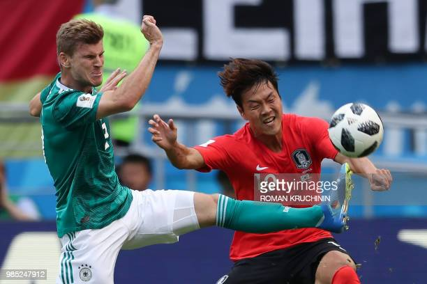 TOPSHOT South Korea's defender Kim Younggwon vies for the ball with Germany's forward Timo Werner during the Russia 2018 World Cup Group F football...