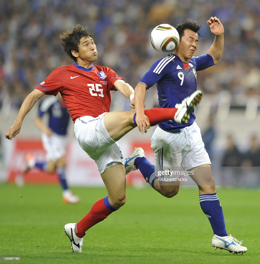 South Korea's defender Lee Jung-Soo (L) and Japaan's forward Shinji Okazaki fight for the ball during their international friendly football match at Saitama Stadium, suburban Tokyo on May 24, 2010. South Korea won the match 2-0. AFP PHOTO/Kazuhiro NOGI