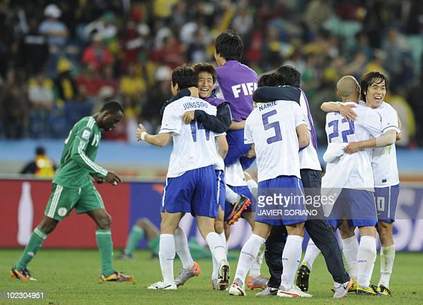 South Korea's defender Lee JungSoo South Korea's midfielder Kim NamIl react after their Group B first round 2010 World Cup football match on June 22...