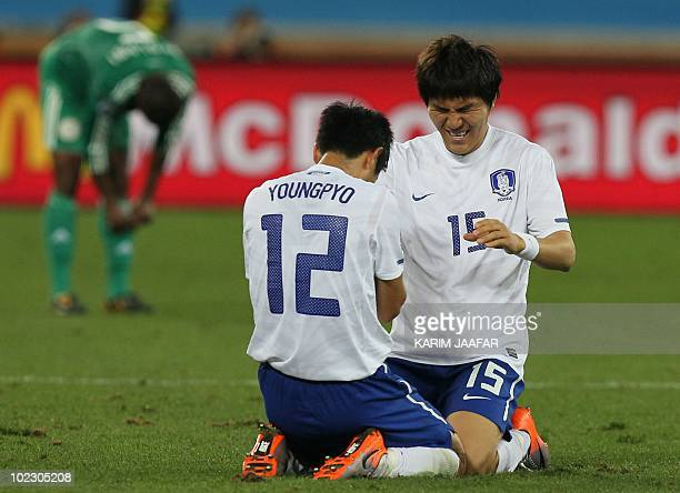 South Korea's defender Lee YoungPyo and South Korea's defender Kim DongJin celebrate after their Group B first round 2010 World Cup football match on...