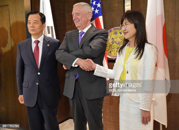 South Korea's Defense Minister Han MinKoo poses with US Pentagon chief Jim Mattis and Japan's Defence Minister Tomomi Inada for a photograph during a...