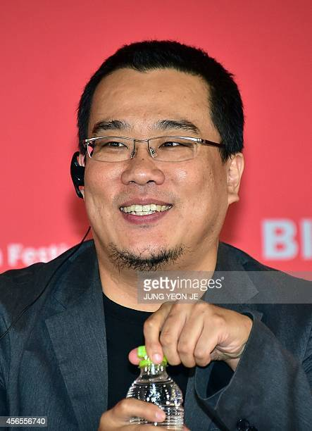 South Korea's director Bong JoonHo smiles during a press conference for the New Currents jury at the 19th Busan International Film Festival in Busan...