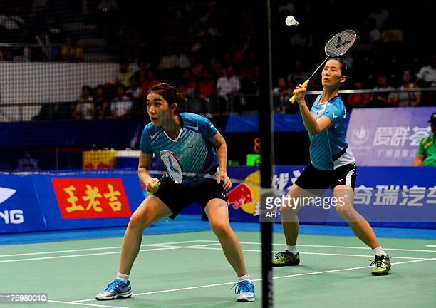South Korea's Eom Hye Won and Jang Ye Na return to China's Wang Xiaoli and Yu Yang during their women's doubles final at World Badminton...