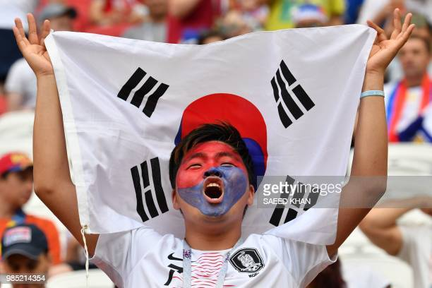 TOPSHOT South Korea's fan cheers prior to the Russia 2018 World Cup Group F football match between South Korea and Germany at the Kazan Arena in...